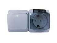 ЭТЮД Блок Выключатель одноклавишный/Розетка наружная с заземлением со шторками IP44 серый (BPA16-241C)